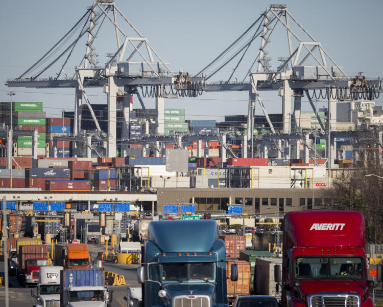 FILE- In this Jan. 30, 2018, file photo, tractor-trailer trucks move cargo in shipping containers out of the Port of Savannah in Savannah, Ga. President Donald Trump announced Friday, June 15, 2018, that starting next month the U.S. will impose a 25 percent tariff on up to $50 billion in Chinese imports. (AP Photo/Stephen B. Morton, File)