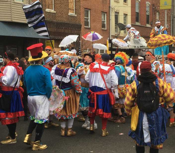Costumed participants take to the streets of their south Philadelphia stomping grounds for a New Year's celebration of Mummers tradition despite official cancellation of the annual event and a ban on large gatherings due to the coronavirus pandemic, Friday, Jan. 1, 2021 in Philadelphia. (AP Photo/Ron Todt)