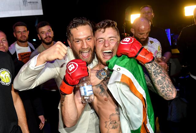 James Gallagher celebrates with Conor McGregor after defeating Roman Salazar in their contract weight bout at Bellator Dublin at the 3Arena, Dublin. (Photo By David Fitzgerald/Sportsfile via Getty Images)