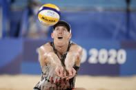 Tri Bourne, of the United States, looks to return a shot during a men's beach volleyball match against Italy at the 2020 Summer Olympics, Sunday, July 25, 2021, in Tokyo, Japan. (AP Photo/Felipe Dana)