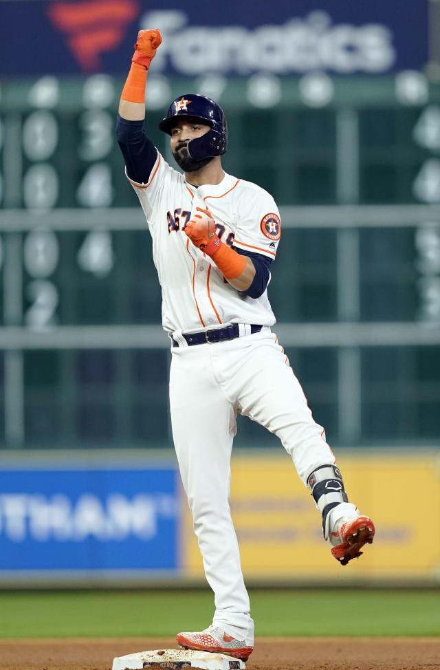 Houston Astros' Marwin Gonzalez celebrates after hitting a RBI double against the Seattle Mariners during the fourth inning of a baseball game Monday, Sept. 17, 2018, in Houston. (AP Photo/David J. Phillip)