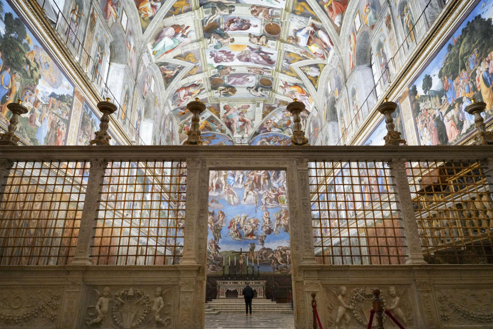 A visitor walks through the Sistine Chapel at the Vatican, Monday, Feb. 1, 2021. The Vatican Museums reopened Monday to visitors after 88 days of shutdown following COVID-19 containment measures. (AP Photo/Andrew Medichini)