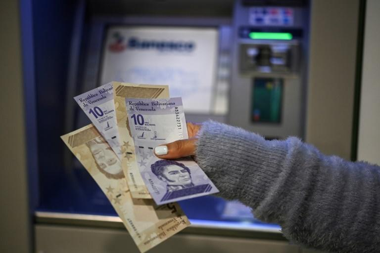 New notes of five and 10 bolivars after Venezuela slashes six zeroes off its currency (AFP/Yuri CORTEZ)