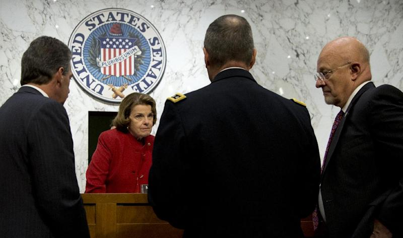Senate Intelligence Committee ChairmaSen. Dianne Feinstein, D-Calif., second from left, talks with from left, Deputy Attorney General James Cole, National Security Agency Director General Keith Alexander, and Director of National Intelligence James Clapper, on Capitol Hill in Washington, Thursday, Sept. 26, 2013, before the start of the committee's hearing on the Foreign Intelligence Surveillance Act (FISA), and National Security Agency (NSA) call records. Lawmakers who oversee US intelligence agencies are working to expand the government's spying powers to allow the FBI to immediately begin electronically monitoring terror suspects who travel to the United States and who already were under surveillance overseas by the NSA. (AP Photo/Carolyn Kaster)