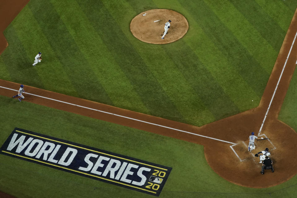 Los Angeles Dodgers' Austin Barnes lays down a RBI bunt against the Tampa Bay Rays during the fourth inning in Game 3 of the baseball World Series Friday, Oct. 23, 2020, in Arlington, Texas. (AP Photo/David J. Phillip)