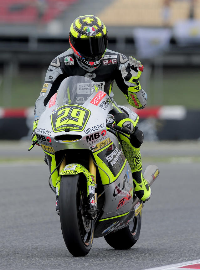 Speed Master's Italian Andrea Iannone celebrates after winning the Moto2 race of the Catalunya Moto GP Grand Prix at the Catalunya racetrack in Montmelo, near Barcelona, on June 3, 2012. Speed Master's Italian Andrea Iannone won the race ahead of Interwetten-Paddock's Swiss Thomas Luthi and Team CatalunyaCaixa Repsol 's Spanish Marc Marquez. AFP PHOTO / JOSEP LAGOJOSEP LAGO/AFP/GettyImages
