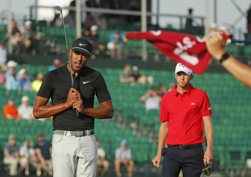FILE - In this June 17, 2018, file photo, Tony Finau, left, reacts after a putt on the 16th green during the final round of the U.S. Open Golf Championship, in Southampton, N.Y. Finau has no problem with Nike's new campaign with Colin Kaepernick. (AP Photo/Carolyn Kaster, File)