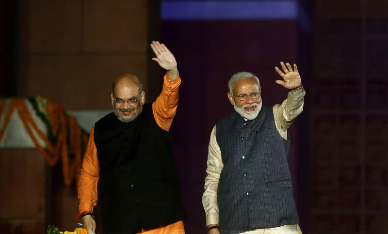 FILE PHOTO: Indian Prime Minister Narendra Modi and Bharatiya Janata Party (BJP) President Amit Shah wave towards their supporters after the election results at party headquarter in New Delhi