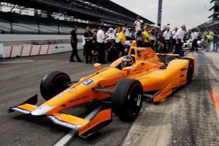 May 20, 2017; Indianapolis, IN, USA; Fernando Alonso drives out of the pits during his  qualifying run for the 101st Running of the Indianapolis 500 at Indianapolis Motor Speedway. Mandatory Credit: Thomas J. Russo-USA TODAY Sports