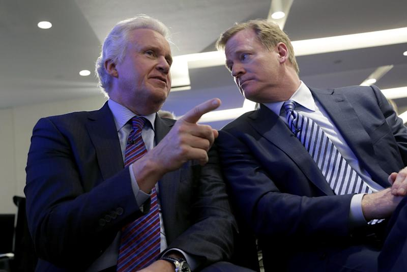 General Electric Chairman and CEO Jeff Immelt, left, talks with NFL Commissioner Roger Goodell during an NFL football news conference in New York, Monday, March 11, 2013. GE is partnering with the NFL, the U.S. Military and others to further research on head injuries. (AP Photo/Seth Wenig)