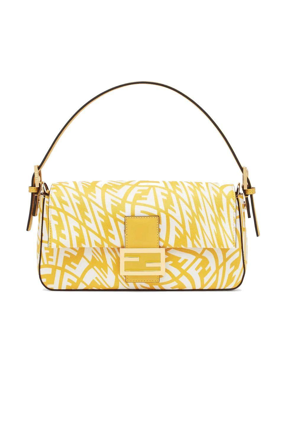 """<p><a class=""""link rapid-noclick-resp"""" href=""""https://www.fendi.com/gb/baguette-1997-yellow-glazed-canvas-bag/p-8br792afl1f1e8k"""" rel=""""nofollow noopener"""" target=""""_blank"""" data-ylk=""""slk:SHOP NOW"""">SHOP NOW</a></p><p>The Baguette is one of Fendi's most well-known handbags. Named after the French loaf, the accessory is small and simple and can be tucked delicately under the arm. Over the years the bag has been updated and transformed in many ways – <a href=""""https://www.fendi.com/gb/woman-bags/baguette"""" rel=""""nofollow noopener"""" target=""""_blank"""" data-ylk=""""slk:and the house has recently re-issued some of the styles first released in 1997"""" class=""""link rapid-noclick-resp"""">and the house has recently re-issued some of the styles first released in 1997</a> (including this fun yellow design), all of which will definitely stand the test of time.</p><p>Jacquard and raffia bag, £1,850, <a href=""""https://www.fendi.com/gb/baguette-1997-yellow-glazed-canvas-bag/p-8br792afl1f1e8k"""" rel=""""nofollow noopener"""" target=""""_blank"""" data-ylk=""""slk:Fendi"""" class=""""link rapid-noclick-resp"""">Fendi</a></p>"""