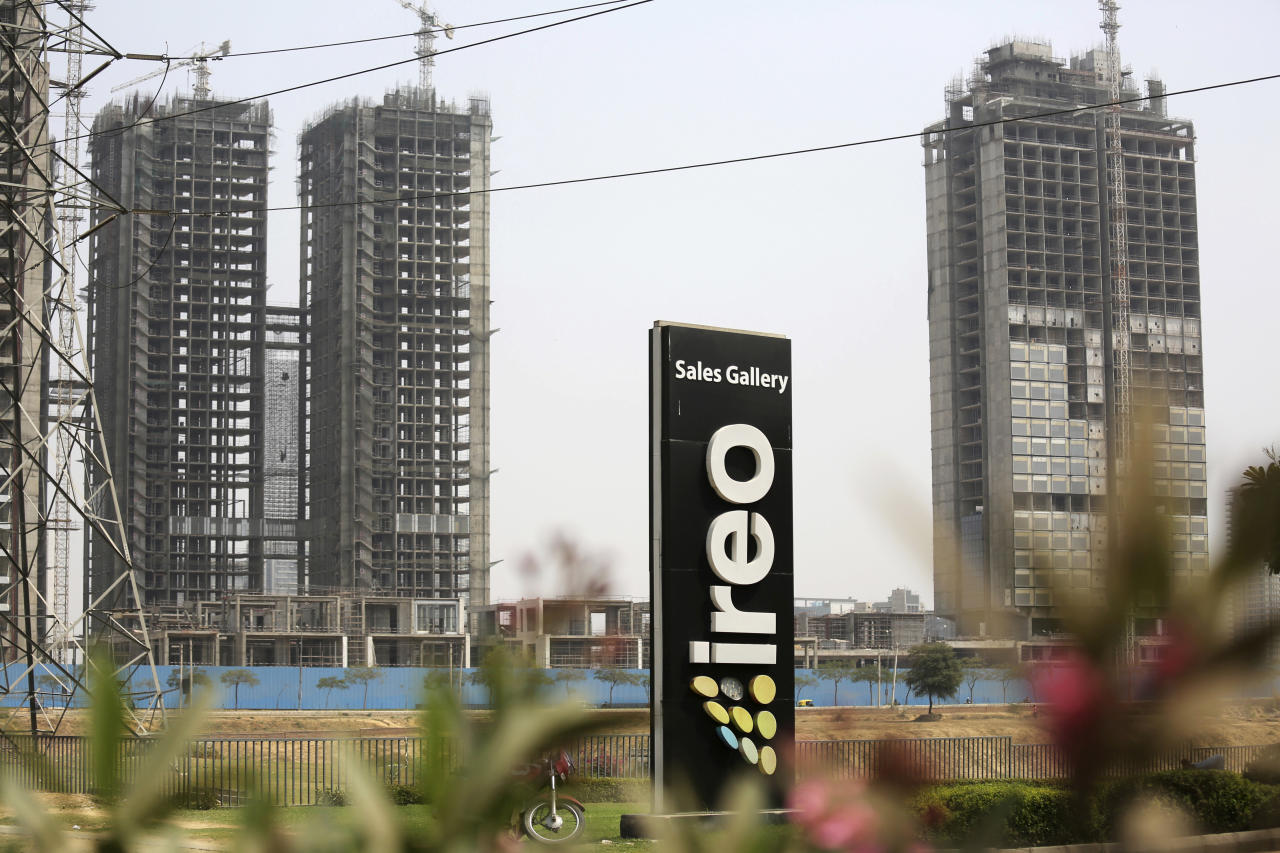 <p> A signboard advertising IREO stands in front of buildings being constructed by the real estate firm in Gurgaon, India, Tuesday, March 20, 2018. The Indian company that is partnering with the Trump Organization on an office tower project has been accused of running an elaborate real estate swindle that cheated investors out of nearly $150 million, according to complaints filed with Indian authorities. The documents make no mention of the Trump Organization, and focus largely on two real estate deals that began years before the organization signed a 2016 agreement with IREO to partner on an office tower in Gurgaon, outside New Delhi. (AP Photo/Oinam Anand) </p>