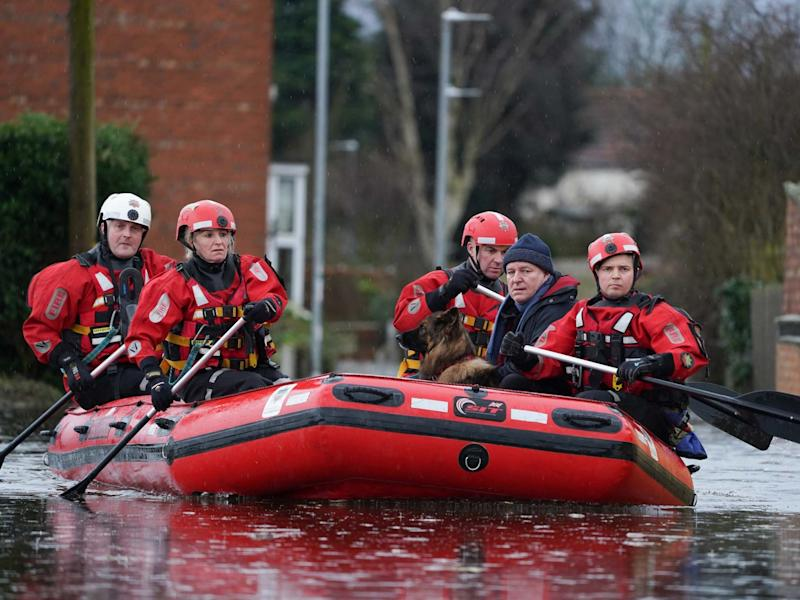 Humberside Fire and Rescue services rescue a resident and his dog from a home in Snaith, East Yorkshire, after the River Aire bursts its banks, 29 February 2020: Getty Images