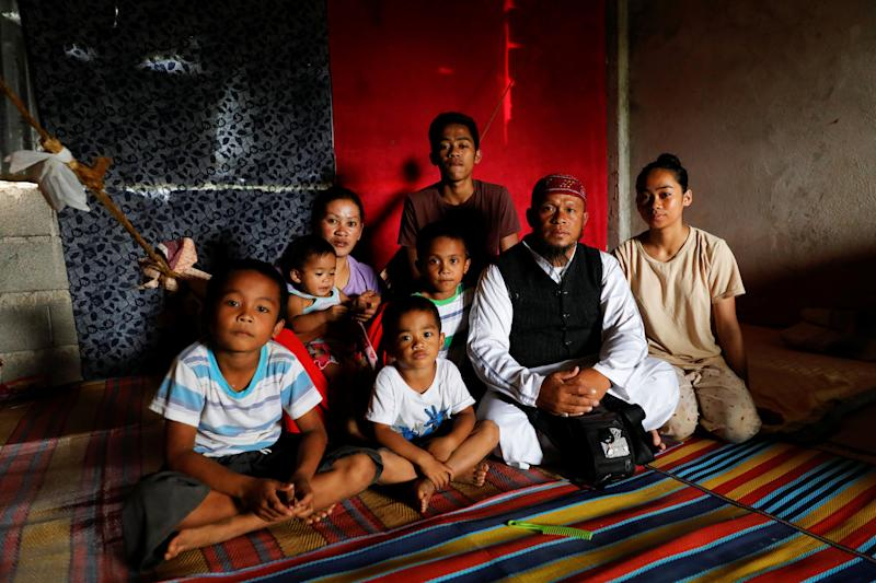 Mohammad Ali Acampong, 42, poses for a portrait with his family in a school-turned-evacuation center at Mipaga, Marawi City, Lanao del Sur province, Philippines. (Photo: Eloisa Lopez/Reuters)