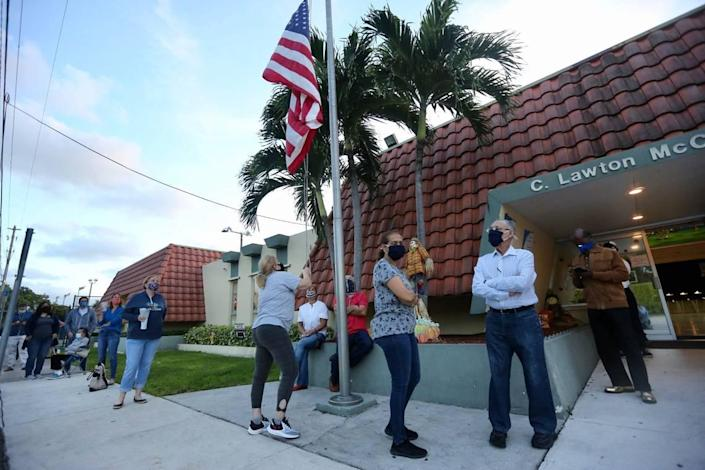 Voters lined up before doors opened at 7 a.m. Tuesday, Nov. 3, 2020, at the C . Lawton McCall Community Center in Miami Shores.