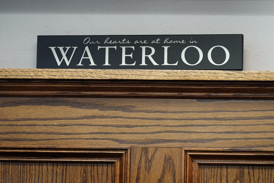 A sign sits on a shelf in the office of Waterloo Mayor Quentin Hart, Tuesday, Sept. 7, 2021, in Waterloo, Iowa. Joel Fitzgerald, the first Black police chief in Waterloo, is facing intense opposition from some current and former officers as he works with city leaders to reform the department, including the removal of its longtime insignia that resembles a Ku Klux Klan dragon. (AP Photo/Charlie Neibergall)