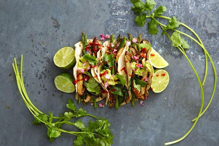 """<p>Let's take Taco Tuesday to the next level, shall we? These beauties are filled to the brim with asparagus, shiitakes, and lots of guac. </p><p><em><a href=""""https://www.goodhousekeeping.com/food-recipes/a38332/grilled-asparagus-and-shiitake-tacos-recipe/"""" rel=""""nofollow noopener"""" target=""""_blank"""" data-ylk=""""slk:Get the recipe for Grilled Asparagus and Shiitake Tacos »"""" class=""""link rapid-noclick-resp"""">Get the recipe for Grilled Asparagus and Shiitake Tacos »</a></em> </p>"""
