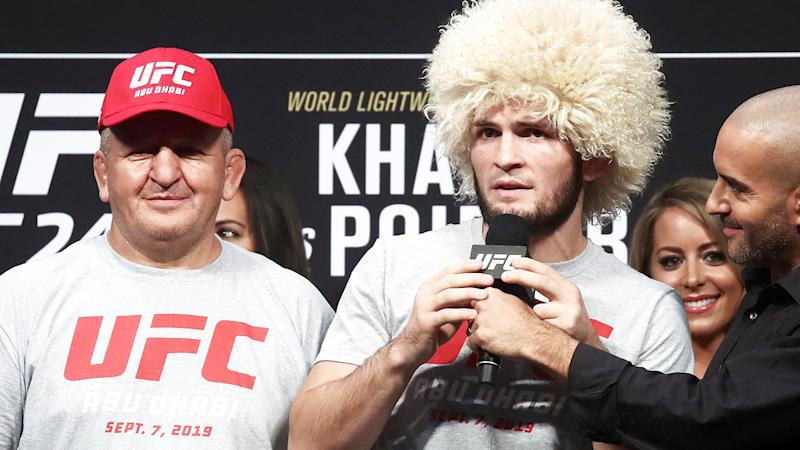 Khabib Nurmagomedov, pictured here with father and coach Abdulmanap at UFC 242.
