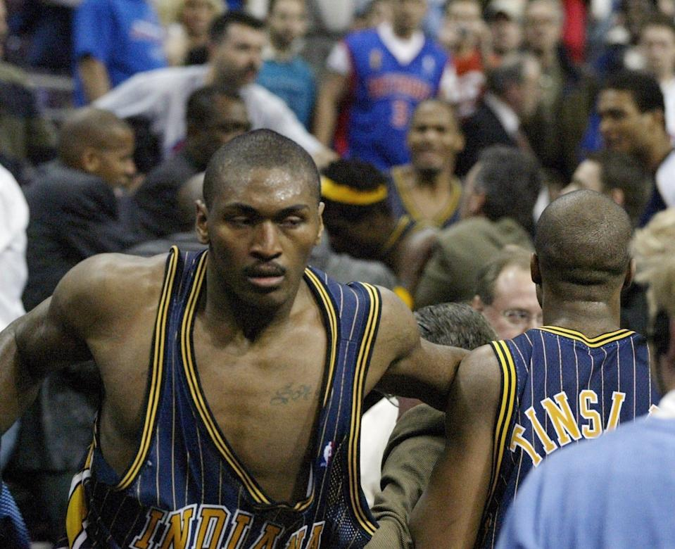 Indiana Pacers forward Ron Artest gets back on the court after going into the stands after fans during a brawl with the Detroit Pistons with 45.9 seconds left in the game at the Palace of Auburn Hills, Nov. 19, 2004.