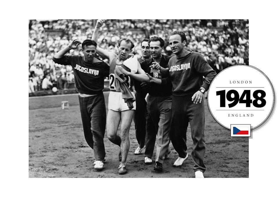 """Representing Czechoslovakia Emil Zátopek, a long-distance runner, won many gold medals at both the 1948 and 1952 Summer Olympics. Here, he was photographed in 1948 after a victory, supported by his team in """"Jugoslavija"""" emblazoned sweatsuits. (Getty Images)"""