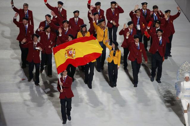 Spain's flag-bearer Javier Fernandez leads his country's contingent during the opening ceremony of the 2014 Sochi Winter Olympics, February 7, 2014. REUTERS/Lucy Nicholson (RUSSIA - Tags: OLYMPICS SPORT)