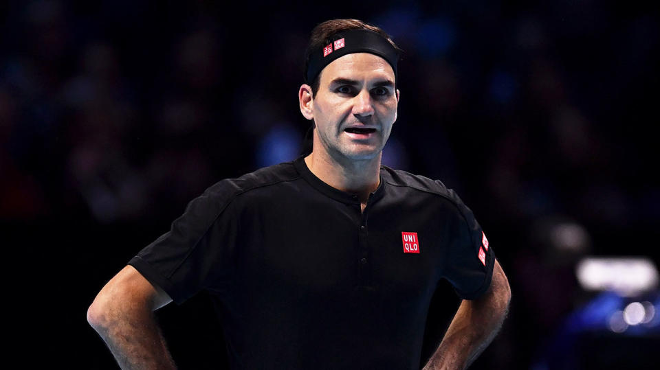 Roger Federer reacts as he questions a line call in his singles match against Dominic Thiem. (Photo by Justin Setterfield/Getty Images)