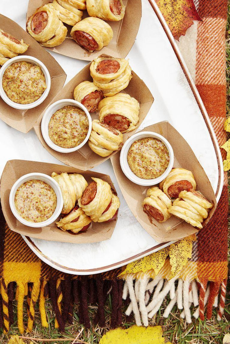"<p>These delectable bites are super easy to make thanks to packaged puff pastry. </p><p><strong><a href=""https://www.countryliving.com/food-drinks/a24281158/cajun-sausage-puffs-bourbon-mustard-recipe/"" rel=""nofollow noopener"" target=""_blank"" data-ylk=""slk:Get the recipe"" class=""link rapid-noclick-resp"">Get the recipe</a>.</strong></p><p><a class=""link rapid-noclick-resp"" href=""https://www.amazon.com/Nordic-Ware-Natural-Aluminum-Commercial/dp/B0049C2S32/?tag=syn-yahoo-20&ascsubtag=%5Bartid%7C10050.g.2966%5Bsrc%7Cyahoo-us"" rel=""nofollow noopener"" target=""_blank"" data-ylk=""slk:SHOP BAKING SHEETS"">SHOP BAKING SHEETS</a></p>"