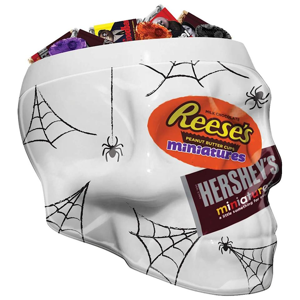 """This Hershey x Addams Family collaboration is the secret to a stress-free Halloween. If you don't have time to pass out candy all night, display this Reeses and Hershey-filled skull on your front porch with a """"Please Take One"""" sign.  <strong>Buy it!</strong> $21.90; <a href=""""https://www.amazon.com/Hersheys-Halloween-Miniatures-Assortment-Addams/dp/B07PDJ6DPZ"""">amazon.com</a>"""