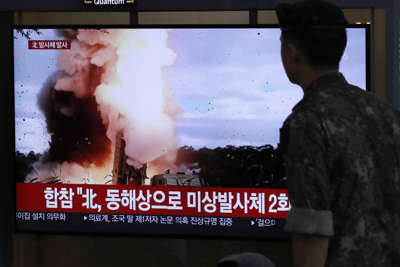 """A South Korean soldier watches a TV screen showing a news program reporting about North Korea's firing projectiles with a file image at the Seoul Railway Station in Seoul, South Korea, Saturday, Aug. 24, 2019. North Korea fired two suspected short-range ballistic missiles off its east coast on Saturday in the seventh consecutive week of weapons tests, South Korea's military said, a day after it threatened to remain America's biggest threat in protest of U.S.-led sanctions on the country. The Korean letters on TV read: """"North Korea fired projectiles."""" (AP Photo/Lee Jin-man)"""