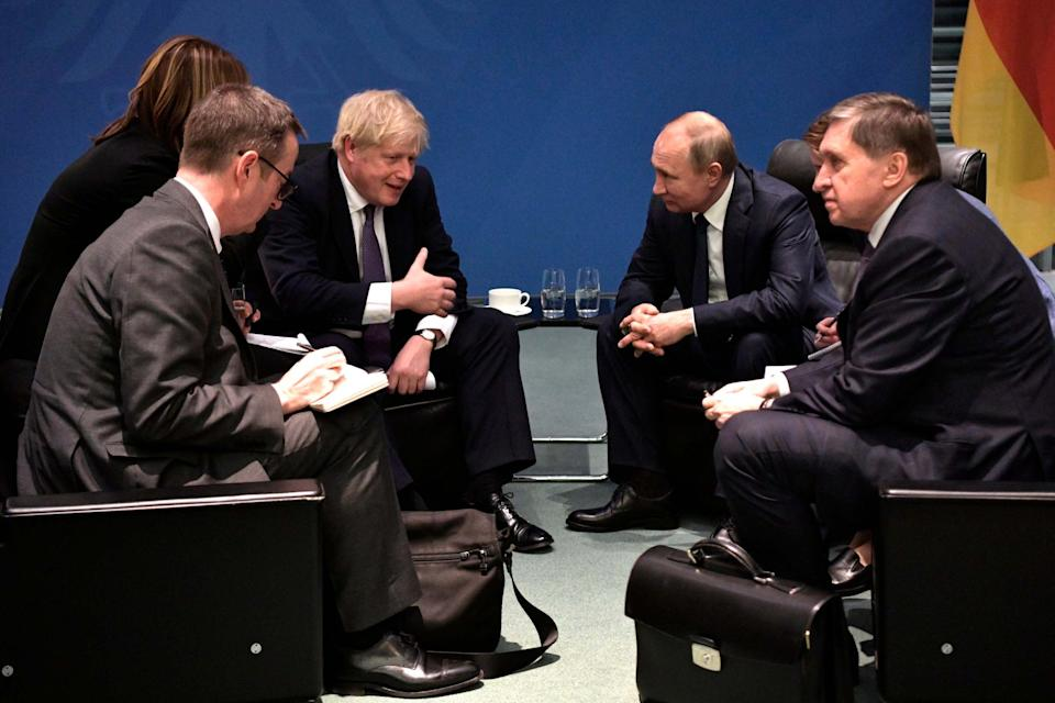 Boris Johnson and Vladimir Putin talk to each other during their meeting on the sideline of a conference on Libya(AP)