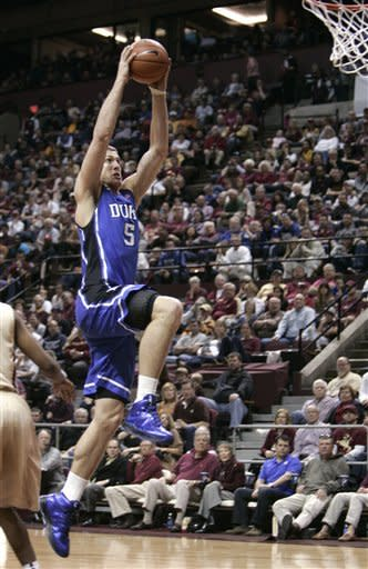 Duke's Mason Plumlee takes off for a dunk against Florida State in the second half of an NCAA college basketball game Saturday, Feb. 2, 2013, in Tallahassee, Fla. Duke won 79-60. (AP Photo/Steve Cannon)