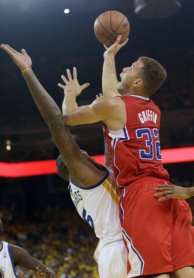 Los Angeles Clippers forward Blake Griffin (32) shoots over Golden State Warriors forward Marreese Speights during the first half of Game 6 of an opening-round NBA basketball playoff series in Oakland, Calif., Thursday, May 1, 2014. (AP Photo/Marcio Jose Sanchez)