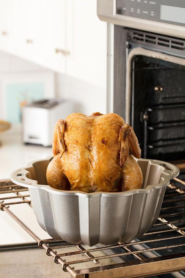 """<p>This easy hack results in a perfect roast chicken, and the veggies to go along with it!</p><p>Get the recipe from <a href=""""https://www.delish.com/cooking/recipe-ideas/recipes/a51763/bundt-pan-roast-chicken-recipe/"""" rel=""""nofollow noopener"""" target=""""_blank"""" data-ylk=""""slk:Delish"""" class=""""link rapid-noclick-resp"""">Delish</a>.</p>"""