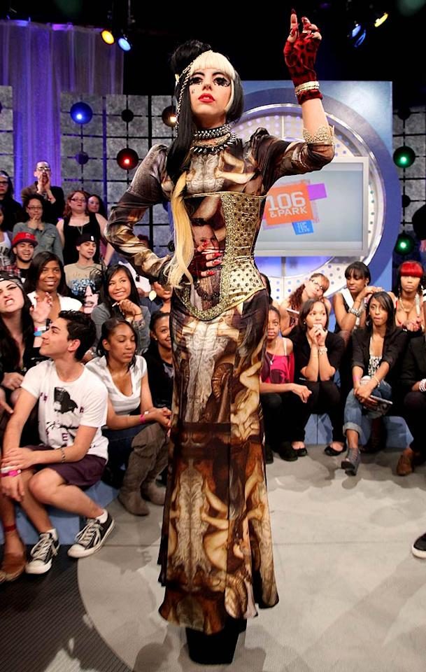 """A day later, the """"Judas"""" songstress appeared on BET's """"106 & Park"""" -- to promote her new album, <i>Born This Way</i> -- in a spiked collar, Renaissance-inspired dress, gold corset, and sky-high platform heels. Discuss. Johnny Nunez/<a href=""""http://www.wireimage.com"""" target=""""new"""">WireImage.com</a> - May 24, 2011"""