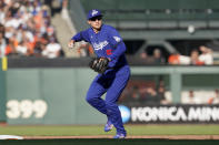 Los Angeles Dodgers' Corey Seager throws to first base on a double play hit into by San Francisco Giants' Brandon Belt during the fourth inning of a baseball game in San Francisco, Sunday, Sept. 5, 2021. (AP Photo/Jeff Chiu)
