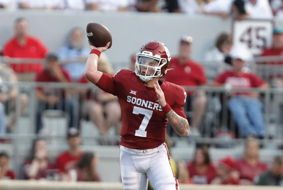 Oklahoma quarterback Spencer Rattler passes the ball against Western Carolina during the first half of an NCAA college football game Saturday, Sept. 11, 2021, in Norman, Okla. (AP Photo/Alonzo Adams)
