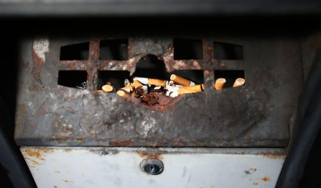 Cigarettes in an outside ashtray (Lynne Cameron/PA)