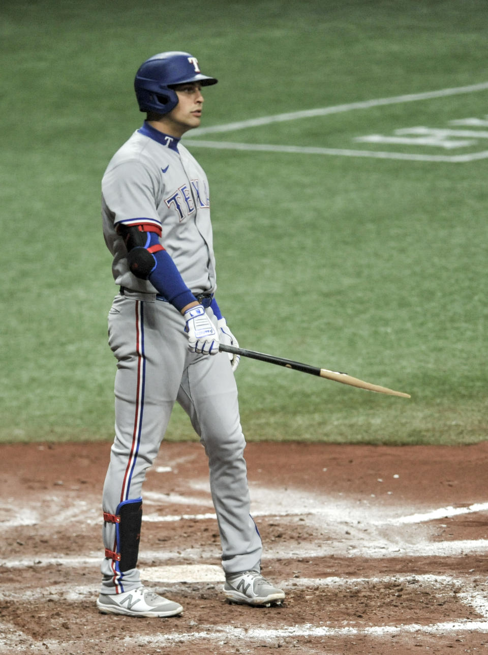 Texas Rangers' Nate Lowe hold his broken bat during the seventh inning of a baseball game against the Tampa Bay Rays Monday, April 12, 2021, in St. Petersburg, Fla. (AP Photo/Steve Nesius)