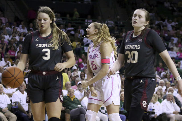 Baylor forward Lauren Cox (15) reacts between Oklahoma forward Mandy Simpson (3) and guard Taylor Robertson (30) in the first half of an NCAA college basketball game Saturday, Feb. 22, 2020, in Waco, Texas. (AP Photo/Jerry Larson)