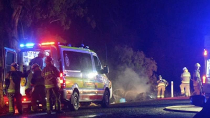 Three men have died and a woman is fighting for her life after a car hit a tree and burst into flames in regional Queensland.