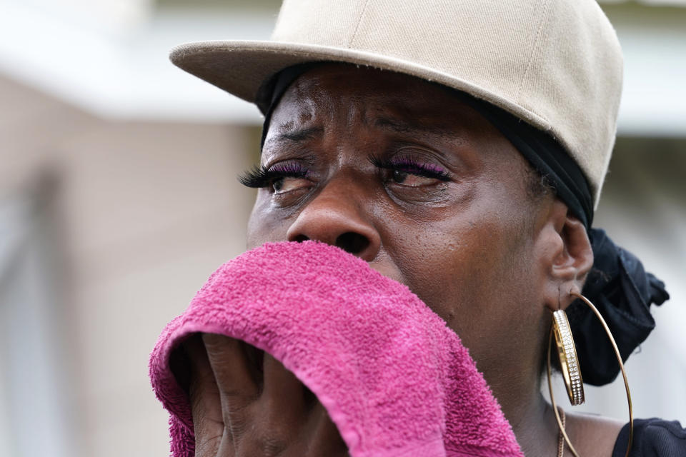 Rakisha Murray cries in relief as she arrives to see her mother's home largely undamaged, after she returned from evacuation with her mother and other family in Lake Charles, La., in the aftermath of Hurricane Laura, Sunday, Aug. 30, 2020. (AP Photo/Gerald Herbert)