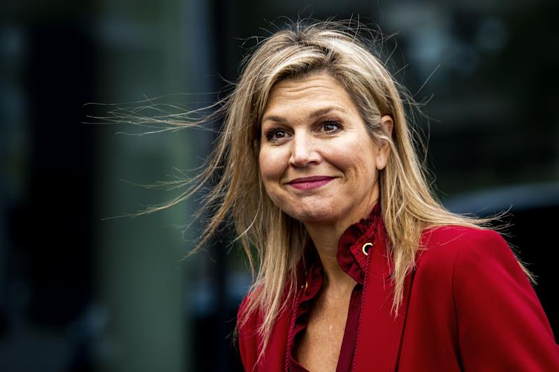 Queen Maxima fashioned a red power suit at a business forum in The Netherlands. Photo: Getty