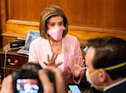 <p>Representative Pelosi matched her face mask to her pink pantsuit at the ceremonial swearing in of Representative Elect Kweisi Mfume of Maryland. Pelosi wore the mask after the CDC recommended face coverings, in order to best prevent the spread of COVID-19. </p>