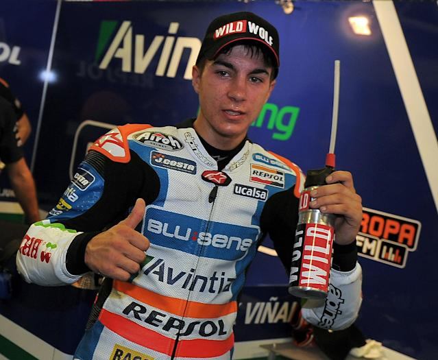 Blusens Avintia's Spanish Maverick Vinales celebrates taking the pole position at the Catalunya racetrack in Montmelo, near Barcelona, on June 2, 2012, during the Moto3 qualifying session of the Catalunya Moto GP Grand Prix. AFP PHOTO/LLUIS GENELLUIS GENE/AFP/GettyImages