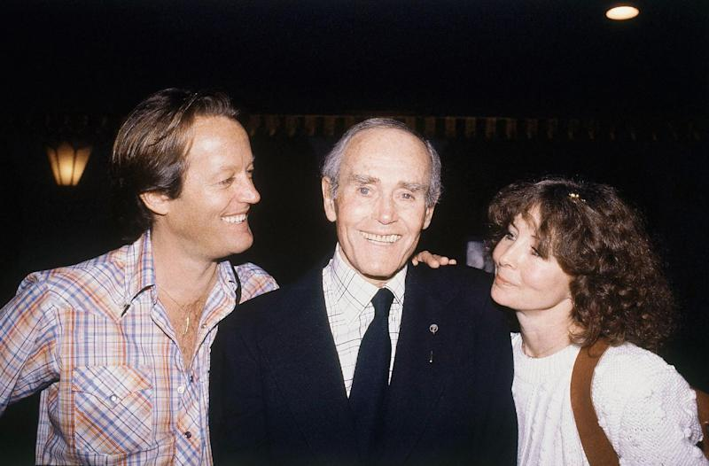 "FILE - In this May 16, 1980 file photo, Henry Fonda, center, is seen on his 75th birthday with son, Peter Fonda, left, and his wife, Shirlee Fonda. On on Saturday, April 27, 2013, Jane Fonda, the 75-year-old Oscar winner , will place her hand and footprints next to her father's in the concrete shrine to celebrity outside Hollywood's TCL Chinese Theatre. Then she'll present a special screening of the film she made with her dad, ""On Golden Pond."" The cement and cinematic tribute is part of the 2013 TCM Classic Film Festival, which is honoring Jane Fonda.(AP Photo/Randy Rasmussen, file)"