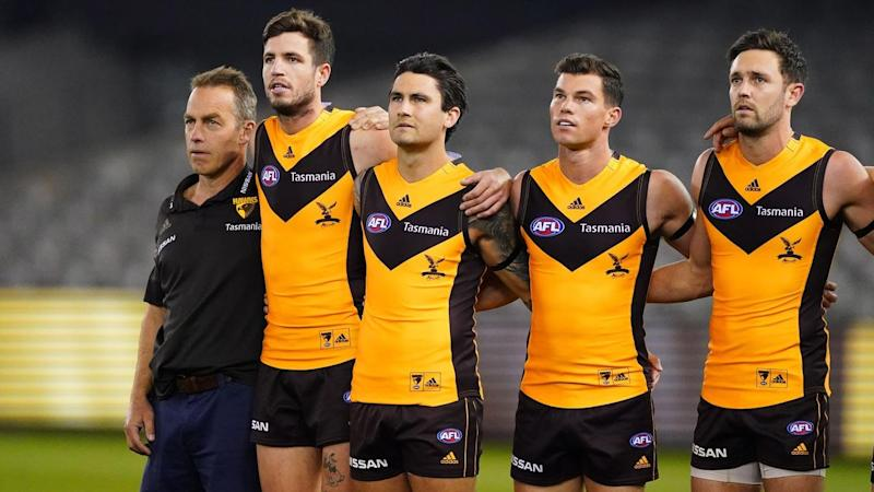 Hawthorn coach Alastair Clarkson (L) wants AFL to be opened up after a dour win over North Melbourne