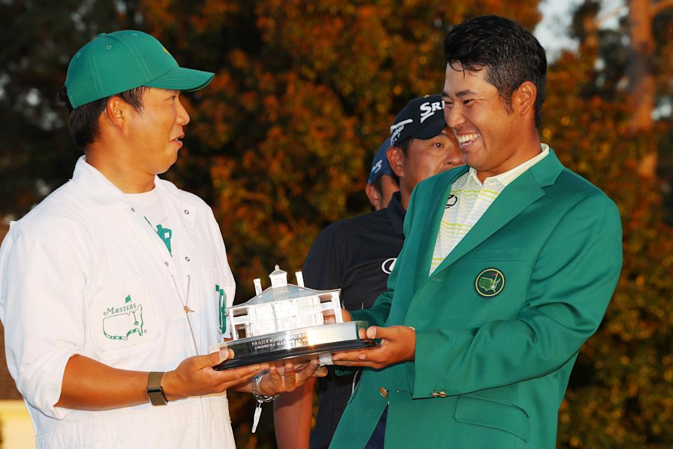 AUGUSTA, GEORGIA - APRIL 11: Hideki Matsuyama of Japan poses with his caddie, Shota Hayafuji, and the Masters Trophy during the Green Jacket Ceremony after winning the Masters at Augusta National Golf Club on April 11, 2021 in Augusta, Georgia. (Photo by Kevin C. Cox/Getty Images)