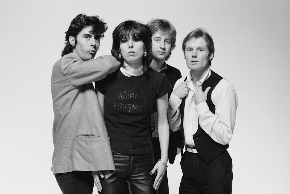 The Pretenders (bassist Pete Farndon (1952-1983), singer and guitarist Chrissie Hynde, guitarist James Honeyman-Scott (1956-1982) and drummer Martin Chambers), British rock band, pose for a group studio portrait, against a white background, United Kingdom, in January 1979. (Photo by Fin Costello/Redferns/Getty Images)