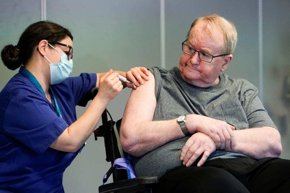 Svein Andersen, 67 years-old resident of 'Ellingsrud home' and first in Norway to receive the vaccine is given the Pfizer-Biontech Covid-19 corona virus vaccine by Nurse Maria Golding in Oslo, Norway, on December 27, 2020. - The European Union began a vaccine rollout, even as countries in the bloc were forced back into lockdown by a new strain of the virus, believed to be more infectious, that continues to spread from Britain. The pandemic has claimed more than 1.7 million lives and is still running rampant in much of the world, but the recent launching of innoculation campaigns has boosted hopes that 2021 could bring a respite. (Photo by Fredrik Hagen / NTB / AFP) / Norway OUT (Photo by FREDRIK HAGEN/NTB/AFP via Getty Images)