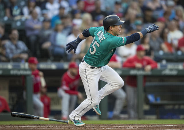 Seattle Mariners' Dylan Moore runs to first base after hitting an RBI single off Los Angeles Angels starting pitcher Tyler Skaggs during the third inning of a baseball game Friday, May 31, 2019, in Seattle. (AP Photo/Stephen Brashear)